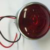 Baklampa   Rött glas  56 mm  i   Plåt  Volvo BM.  6611135
